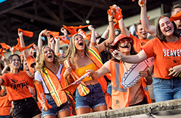 Student fans cheering on the OSU Beavers football team