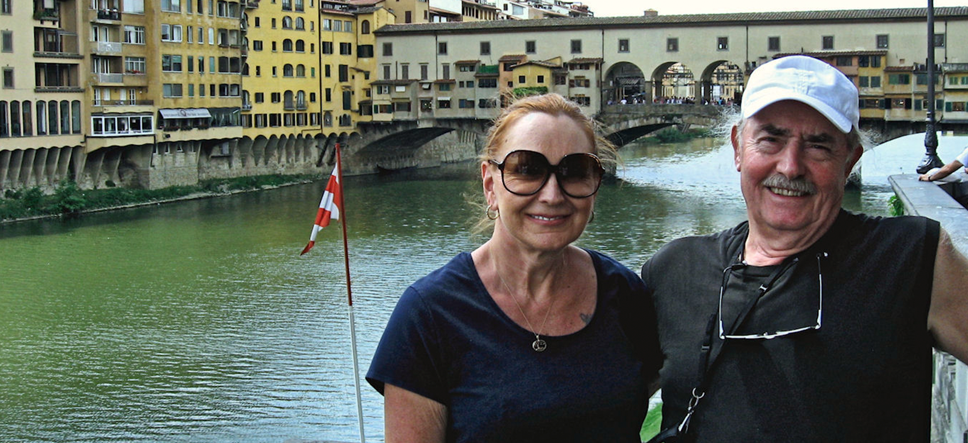 Murray and Linda Smith by a river in Ponte Vicchio