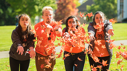 OSU students blowing leaves.
